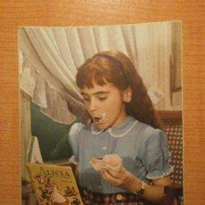 Postales: ANTIGUA POSTAL. NIÑA COMIENDO ESCRITA. Lote 29319497