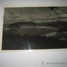 Postales: SAN SEBASTIAN 561 VISTA GENERAL DESDE EL MONTE IGUELDO DE NOCHE FOTO GALARZA CIRCULADA. Lote 8643908