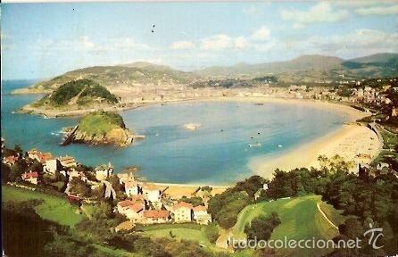 POSTAL A COLOR SAN SEBASTIAN VISTA GENERAL DESDE EL MONTE IGUELDO ESCRITA 1962 MANIPEL (Postales - España - País Vasco Moderna (desde 1940))