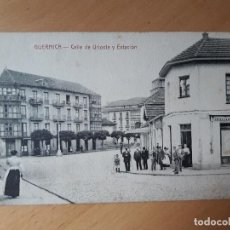 Postales: GUERNICA- CALLE DE URIOSTE Y ESTACIÓN SIN CIRCULAR. Lote 102352887