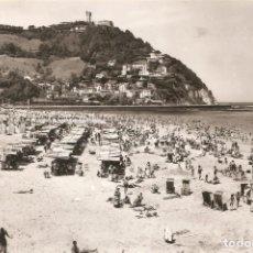 Postales: SAN SEBASTIAN - PLAYA DE ONDARRETA Y .. MANIPEL CIRCULADA EN 1963. Lote 142884010