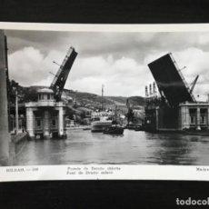 Postales: TARJETA POSTAL DE BILBAO. Nº209. PUENTE DE DEUSTO ABIERTO. ED. MADYMA CIRCULADA 1957. Lote 158261606