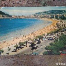 Postales: POSTAL SAN SEBASTIAN TRANVIA COCHES DE EPOCA AÑOS 50-60 CIRCULADA SELLO FRANCO. Lote 240945985