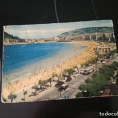 Postales: POSTAL SAN SEBASTIAN COCHES CLASICOS AUTOBUS AÑOS 60 CIRCULADA CON SELLO FRANCO. Lote 261353520