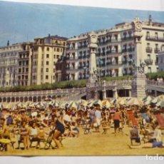 Postales: POSTAL S.SEBASTIAN PLAYA DE LA CONCHA Y RELOJES CIRCULADA. Lote 279429518