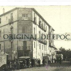 Postales: (PS-25497)POSTAL FOTOGRAFICA DE ARNEDO-SURTIDOR,PARADA COCHE DE LINEA Y CASA FOTOGRAFIA. Lote 29574280