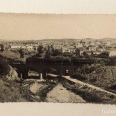 Postales: FERROCARRILS DE CATALUNYA. POSTAL FOTOGRAFICA DE UN TREN PASANDO POR RUBI CIRCULADA AÑO 1962. Lote 115952295