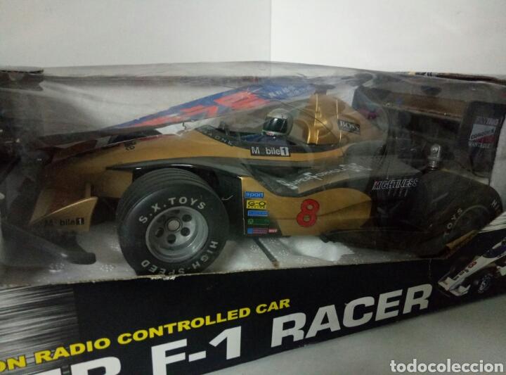 Radio Control: A ESTRENAR! SUPER F1 RACER DORADO COCHE RADICONTROL CAJA DAÑADA MEDIDAS 35X17CMS - Foto 2 - 106927088