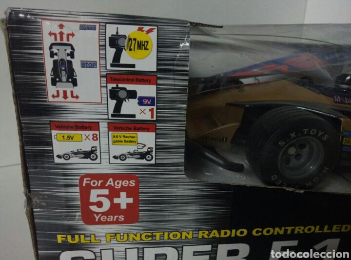 Radio Control: A ESTRENAR! SUPER F1 RACER DORADO COCHE RADICONTROL CAJA DAÑADA MEDIDAS 35X17CMS - Foto 5 - 106927088
