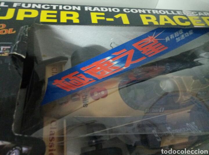 Radio Control: A ESTRENAR! SUPER F1 RACER DORADO COCHE RADICONTROL CAJA DAÑADA MEDIDAS 35X17CMS - Foto 7 - 106927088