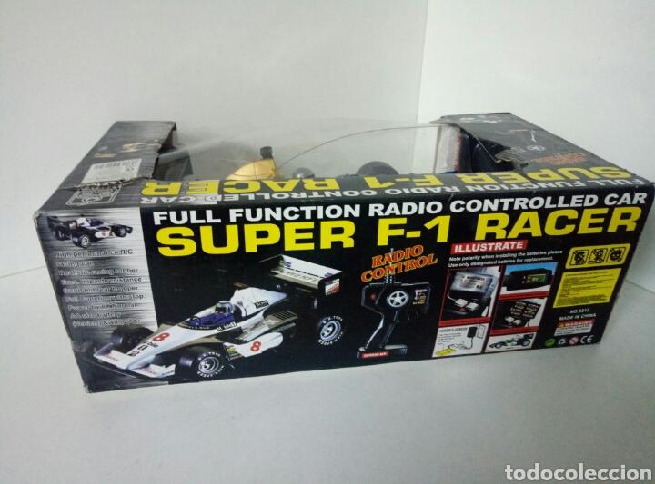 Radio Control: A ESTRENAR! SUPER F1 RACER DORADO COCHE RADICONTROL CAJA DAÑADA MEDIDAS 35X17CMS - Foto 8 - 106927088