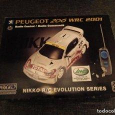 Radio Control: NIKKO PEUGEOT 206 WRC RADIO CONTROL SYSTEM. EVOLUTION SERIES. NUEVO PRECINTADO. Lote 149568902