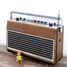 Radios antiguas: RADIO ANTIGUA TRANSSITOR SCHAUB LORENZ TOURING EUROPA EFECTO MADERA ANTIGUA. Lote 42670632