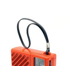 Radios antiguas: RADIO TRANSISTOR MARCA SANYO, MODELO Nº RP 1280. DE PLÁSTICO RESISTENTE COLOR NARANJA. MIDE 10 X 7. Lote 173049144