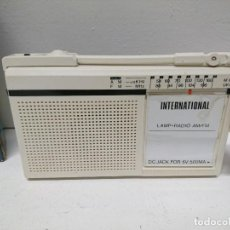 Radios antiguas: RADIO TRANSISTOR CON LINTERNA INTERNATIONAL. Lote 197141433