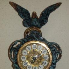 Reloj de Bronce Patinado.