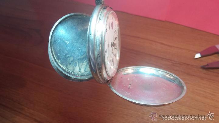 Relojes de bolsillo: Bello conjunto del siglo XIX formado por un reloj de tirete, leontina y su relojera de plata maciza - Foto 71 - 49055502