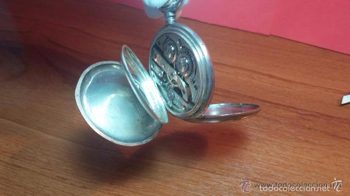 Relojes de bolsillo: Bello conjunto del siglo XIX formado por un reloj de tirete, leontina y su relojera de plata maciza - Foto 72 - 49055502