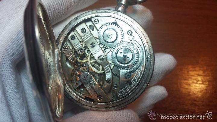 Relojes de bolsillo: Bello conjunto del siglo XIX formado por un reloj de tirete, leontina y su relojera de plata maciza - Foto 85 - 49055502