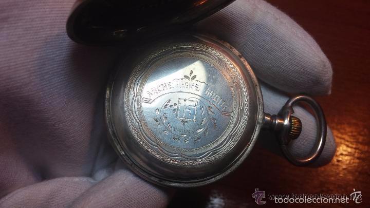 Relojes de bolsillo: Bello conjunto del siglo XIX formado por un reloj de tirete, leontina y su relojera de plata maciza - Foto 92 - 49055502