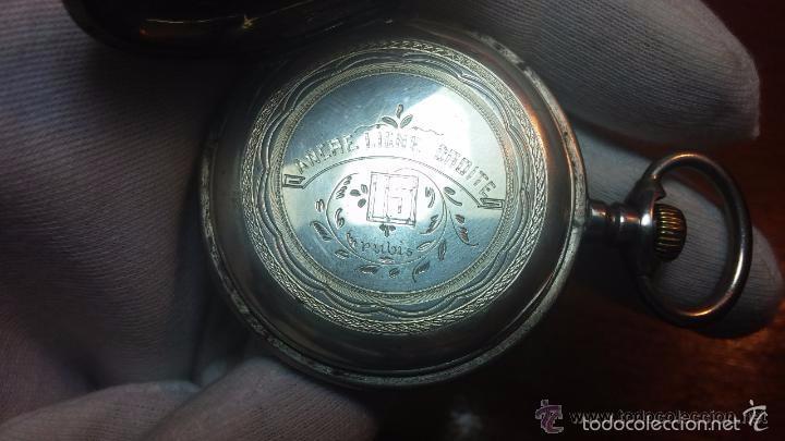 Relojes de bolsillo: Bello conjunto del siglo XIX formado por un reloj de tirete, leontina y su relojera de plata maciza - Foto 94 - 49055502