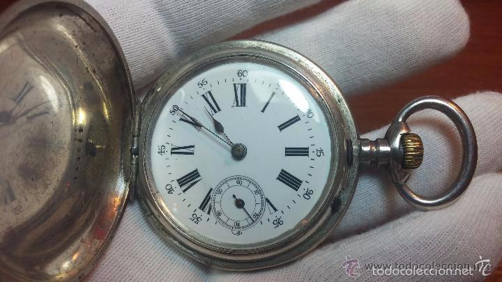 Relojes de bolsillo: Bello conjunto del siglo XIX formado por un reloj de tirete, leontina y su relojera de plata maciza - Foto 104 - 49055502