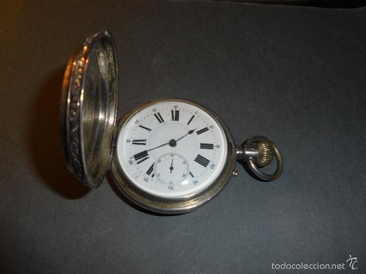 Relojes de bolsillo: ANTIGUO RELOJ DE PLATA 3 TAPAS CINCELADAS FUNCIONANDO , ESFERA DE PORCELA CVINDRE 10 RUBIS REMONTOIR - Foto 3 - 61252023