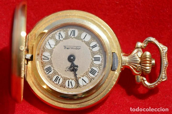 b62650d487bf Antiguo reloj de bolsillo pequeño o de ojal marca thermidor carga manual  baño en oro 17
