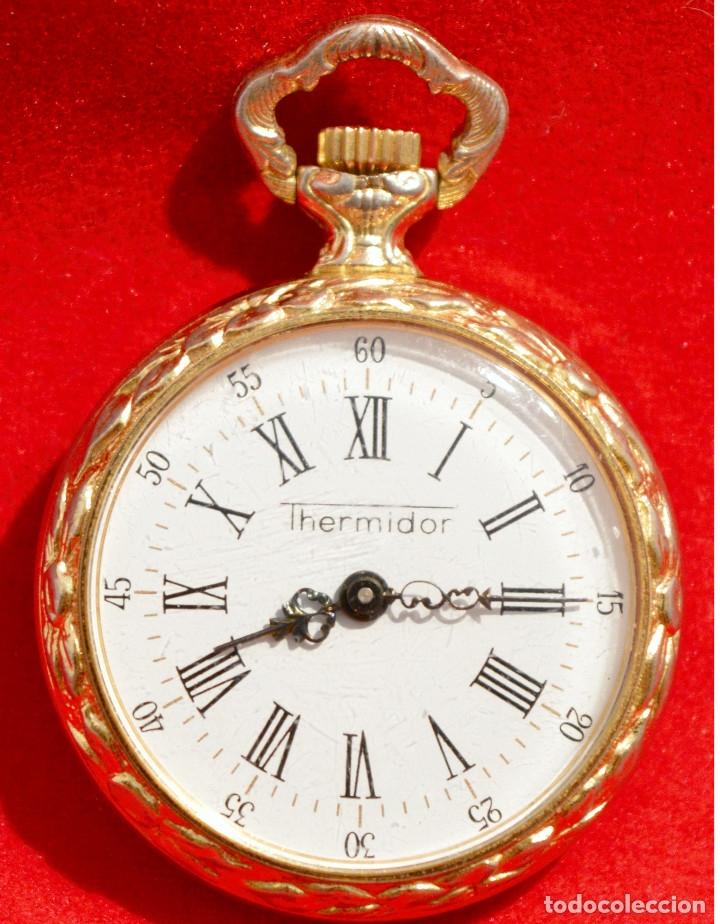 8052bee08038 Antiguo reloj de bolsillo pequeño o de ojal marca thermidor carga manual  baño en oro 17