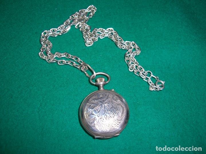 RELOJ DE BOLSILLO COLGANTE CON CADENA EN PLATA. (Relojes - Bolsillo Carga Manual)