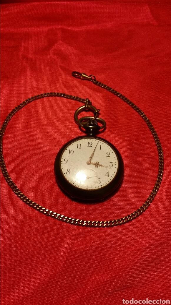 ANTIGUO RELOJ DE BOLSILLO MARCA ACIER GARANTY CAJA DE HIERRO CON INCRUSTACIONES EN LATÓN (Relojes - Bolsillo Carga Manual)