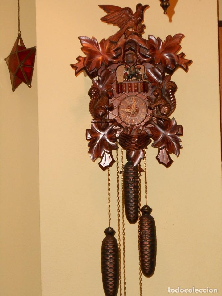 Reloj cucu cuco con carrusel musical 7 8 d as d comprar - Reloj pegado pared ...