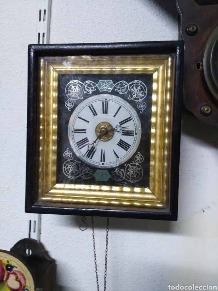 RELOJ SELVA NEGRA CON PAN DE ORO CAMPANA Y BORDÓN Y DESPERTADOR (Relojes - Pared Carga Manual)