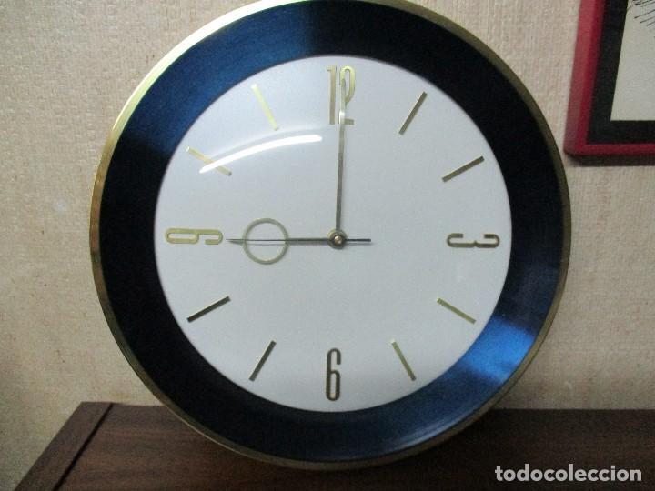 RELOJ DE PARED OJO DE BUEY (Relojes - Pared Carga Manual)