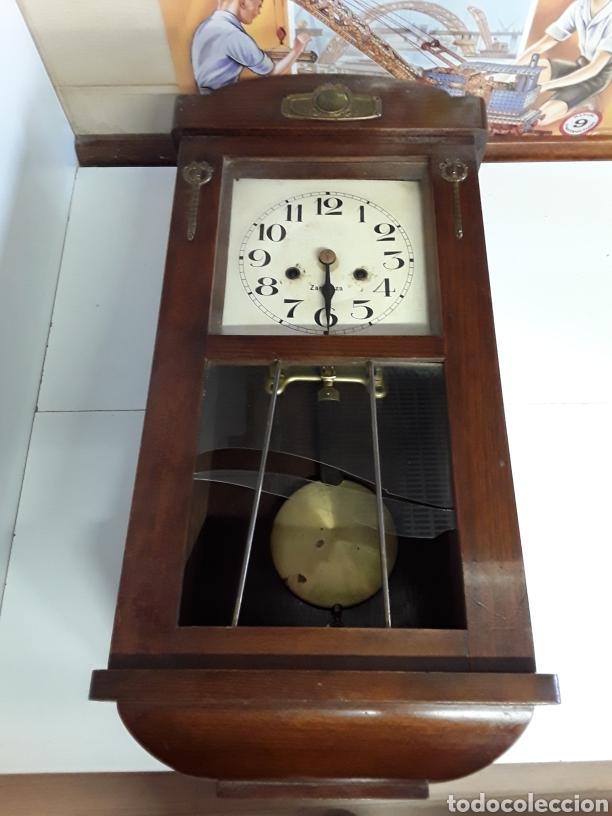 RELOJ ANTIGUO DE PARED FABRICADO EN ZARAGOZA 60X27CM (Relojes - Pared Carga Manual)