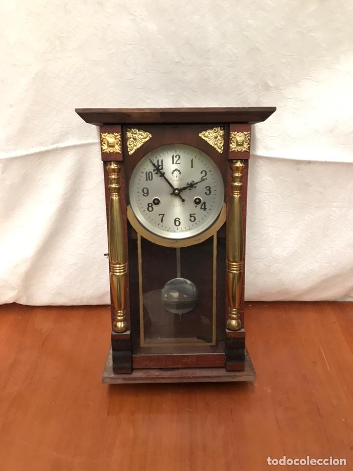 RELOJ DE PAREJ CHINO (Relojes - Pared Carga Manual)