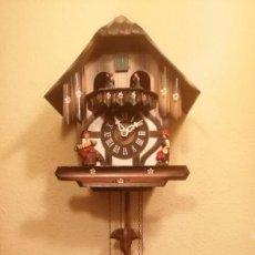 Relojes de pared: RELOJ CUCU-CUCO CON CARRUSEL MUSICAL MADE IN WEST GERMANY(SELVA NEGRA) MECÁNICO Y FUNCIONANDO.. Lote 226690200