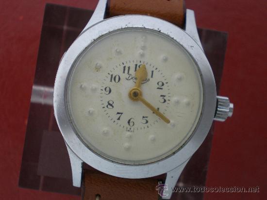 CURIOSO RELOJ PARA CIEGOS CON ESFERA BRAILLE. (Relojes - Pulsera Carga Manual)