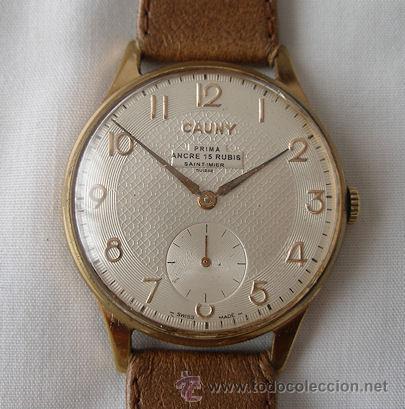 RELOJ CAUNY PRIMA GRANDE TEXTURADO CUERDA (Relojes - Pulsera Carga Manual)