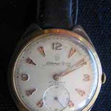 Relojes de pulsera: RELOJ NATIONAL WATCH 17 JEWELS SWISS DE STAINLESS STEEL BACK ANTIMAGNETIC INCABLOC FUNCIONA A CUERDA. Lote 27216875