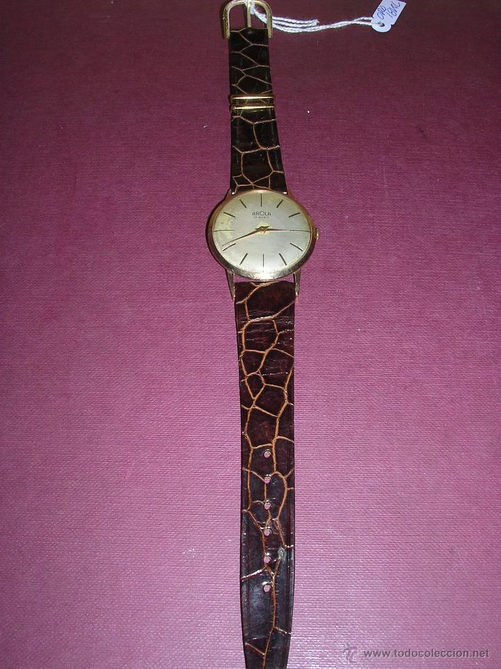 ANTIGUO RELOJ DE PULSERA CARGA MANUAL DE ORO 18KL. MARCA AROLA ,ESTADO DE MARCHA 4,4X3,6 CM. (Relojes - Pulsera Carga Manual)