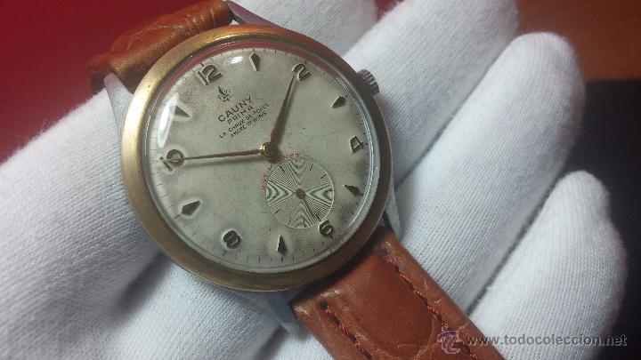 RELOJ SUIZO CAUNY PRIMA, LA CHAUX DE FONS, ESCASO CAL. F-399, ANCRE 17 RUBIS, GRANDE, ANTIMAGNETIC (Relojes - Pulsera Carga Manual)