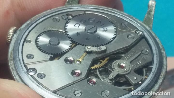 Relojes de pulsera: Botito, enorme y antiquisimo reloj DOGMA de caballero, anda un poquito si se mueve y se para.... - Foto 8 - 73609547