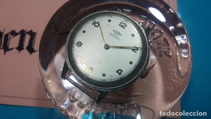 Relojes de pulsera: Botito, enorme y antiquisimo reloj DOGMA de caballero, anda un poquito si se mueve y se para.... - Foto 12 - 73609547