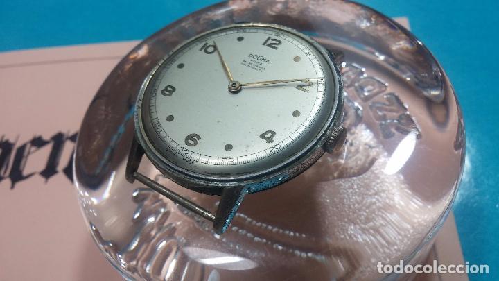 Relojes de pulsera: Botito, enorme y antiquisimo reloj DOGMA de caballero, anda un poquito si se mueve y se para.... - Foto 14 - 73609547