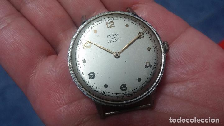 Relojes de pulsera: Botito, enorme y antiquisimo reloj DOGMA de caballero, anda un poquito si se mueve y se para.... - Foto 16 - 73609547