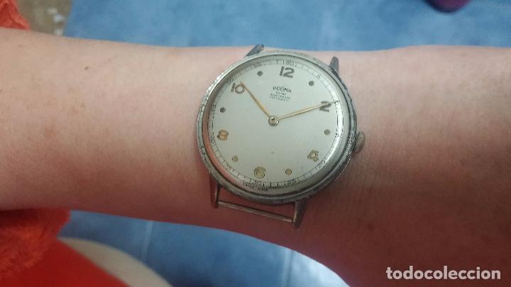 Relojes de pulsera: Botito, enorme y antiquisimo reloj DOGMA de caballero, anda un poquito si se mueve y se para.... - Foto 19 - 73609547