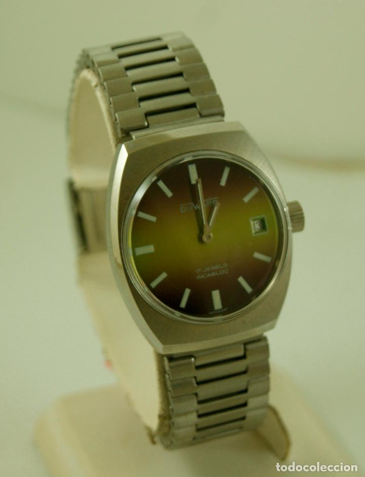 DUWARD MECANICO NOS FUNCIONANDO CON PEGATINAS (Relojes - Pulsera Carga Manual)