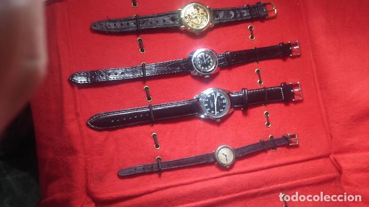 Relojes de pulsera: Botita cartera con reloj de cuerda Olma,los otros 7 relojes de cuerda que contiene se regalan - Foto 9 - 113733395