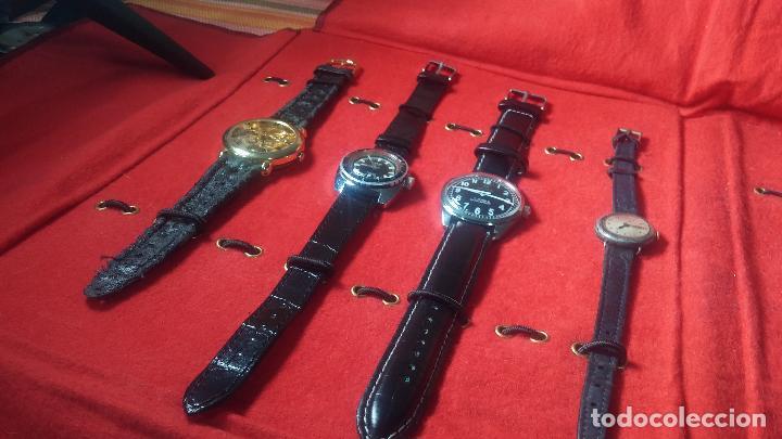 Relojes de pulsera: Botita cartera con reloj de cuerda Olma,los otros 7 relojes de cuerda que contiene se regalan - Foto 10 - 113733395